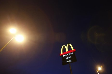 The corporate logo of McDonald's Corp fast food chain is seen on display in the Malaysian town of Pekan May 4, 2013. REUTERS/Bazuki Muhammad
