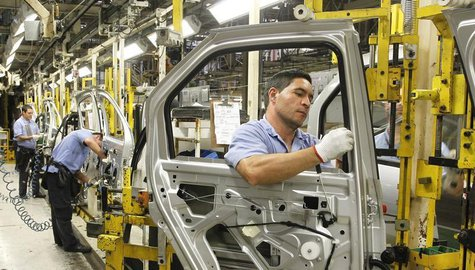 Employees work on the assembly line at the Renault plant in Sao Jose dos Pinhais August 2, 2012. REUTERS/Rodolfo Buhrer