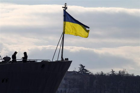 Ukrainian Navy sailors stand guard on top of the Ukrainian navy command ship Slavutych at the Crimean port of Sevastopol March 13, 2014. REU