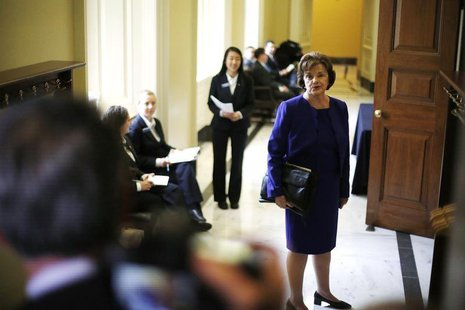 U.S. Senator Dianne Feinstein (D-CA) turns to talk to reporters as she walks to the weekly Democratic caucus policy luncheon at the U.S. Cap