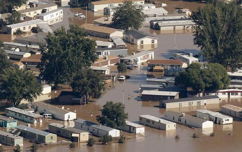 Mobile homes lie flooded in a town in Weld County, Colorado September 17, 2013. REUTERS/Rick Wilking