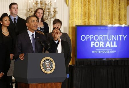 U.S. President Barack Obama talks before signing a Presidential Memorandum on modernizing the overtime system to help insure workers are pai