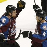 Colorado Avalanche center Ryan O'Reilly (L) celebrates scoring a goal during 2011 action in Denver. REUTERS/Rick Wilking