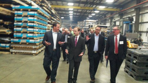 Calley Tours plant with other conferees.
