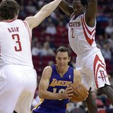 Nov 7, 2013; Houston, TX, USA; Los Angeles Lakers point guard Steve Nash (10) drives against Houston Rockets center Omer Asik (3) and point