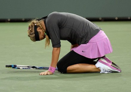 Mar 7, 2014; Indian Wells, CA, USA; Victoria Azarenka (BLR) grimaces as she lands on her left ankle during her match against Lauren Davis (n
