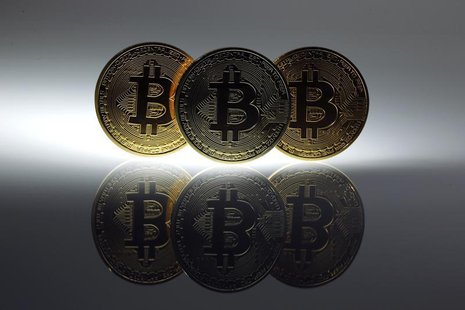 Mock Bitcoins are displayed on a table in an illustration picture taken in Berlin January 7, 2014 file photo. REUTERS/Pawel Kopczynski