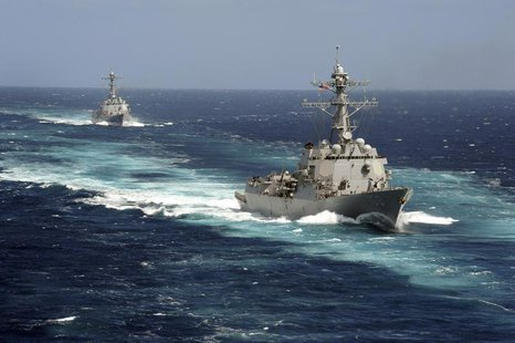 The Arleigh Burke-class guided-missile destroyers USS Kidd and USS Pinckney are seen en transit in the Pacific Ocean in this U.S. Navy pictu