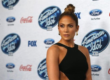 "Singer and judge Jennifer Lopez poses at the party for the finalists of ""American Idol XIII"" in West Hollywood, California February 20, 2014"