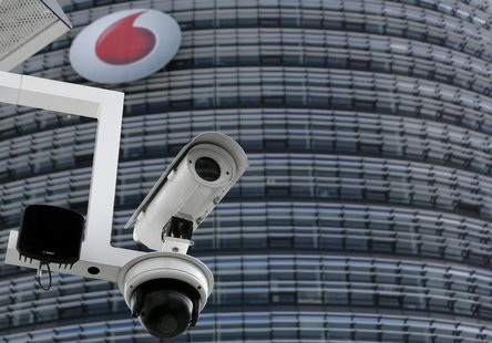 A surveillance camera is pictured in front of the headquarters of Vodafone Germany in Duesseldorf September 12, 2013. REUTERS/Ina Fassbender