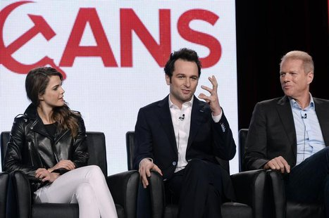 "Cast members Keri Russell (L), Matthew Rhys and Noah Emmerich (R) of drama series ""The Americans"" participate in a panel during FX Networks'"