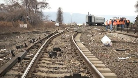 Twisted railroad tracks are seen at the site of a Metro-North train derailment in New York, in this still image from video taken by the Nati
