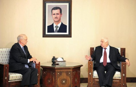 Syria's Foreign Minister Walid Moualem (R) meets United Nations Children's Fund (UNICEF) Director Anthony Lake in Damascus March 12, 2014, i