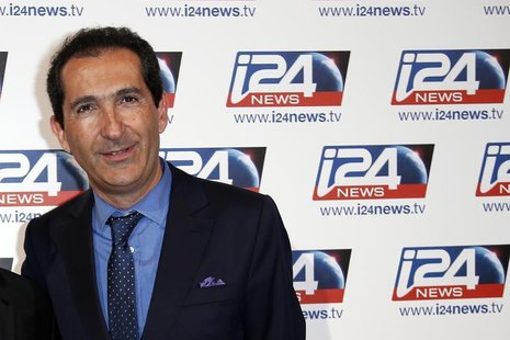 Patrick Drahi, Franco-Israeli businessman and founder of Numericable, poses during a roadshow for the Israel-based broadcast news channel i2