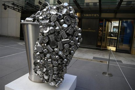 """Spill"", a stainless steel vessel by Subodh Gupta is seen on display during ''The Spring 2-14 Sales of Asian Art Week"" media preview at Chri"