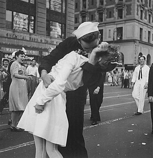 U.S. Navy sailor Glenn Edward McDuffie (L) kisses a nurse in Times Square in an impromptu moment at the close of World War Two, after the su