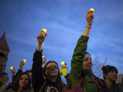 A candle light vigil two days after the 2013 Boston Marathon bombing.  Fears remain that with a higher security presence, a danger remains for 2014. REUTERS/Adrees Latif