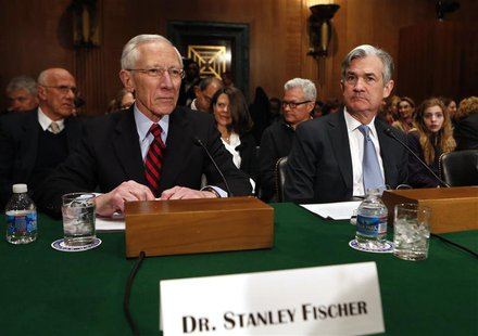 Stanley Fischer (L), the former chief of the Bank of Israel, prepares to testify before the Senate Banking Committee confirmation hearing on
