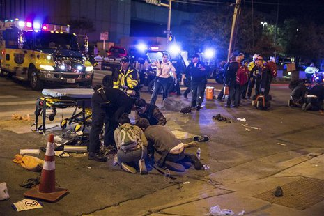A victim who was struck by a vehicle on Red River Street during the SXSW festival is assisted by paramedics and bystanders in downtown Austi