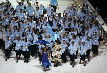 The team from Fiji arrives at the Melbourne Cricket Ground stadium during the Commonwealth Games opening ceremony in Melbourne March 15, 200