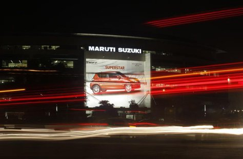 Traffic moves along a busy road in front of the Maruti Suzuki corporate office building in New Delhi July 24, 2013. REUTERS/Anindito Mukherj