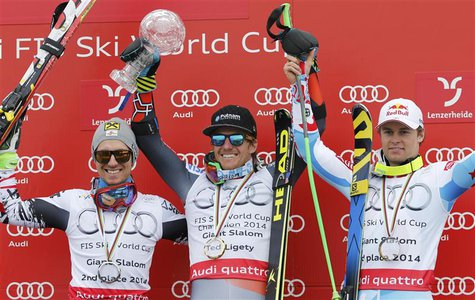 Men's giant slalom winner Ted Ligety of the U.S. is flanked by Austria's runner up Marcel Hirscher (L) and third placed Alexis Pinturault of