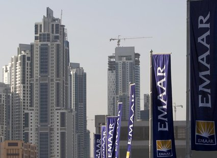 Flags for property company EMAAR, builders of Burj Dubai the world's tallest tower, are seen in Dubai, November 27, 2009. REUTERS/Steve Cris