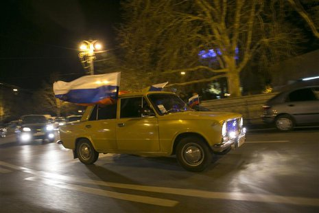 Russian flags are seen on a moving car in Sevastopol, March 15, 2014. REUTERS/Baz Ratner
