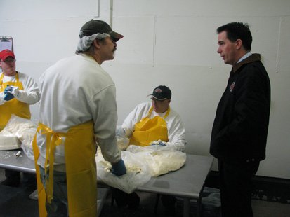 Governor Scott Walker visits with cheese curd packagers at Mosinee Cold Storage.