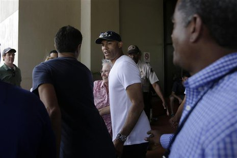 Former Yankees closer pitcher Mariano Rivera (C) is seen during a visit with the New York Yankees team at the Panama Canal in Panama City Ma