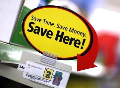 A price sign is displayed at a Dollar General store in Arvada, Colorado June 2, 2009. REUTERS/Rick Wilking