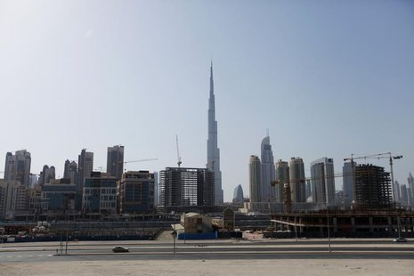 Construction cranes are seen near Burj Khalifa (C) in Dubai June 26, 2012. REUTERS/Jumana El Heloueh
