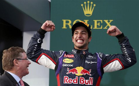 Red Bull Formula One driver Daniel Ricciardo of Australia (R) celebrates finishing second in the Australian F1 Grand Prix at the Albert Park