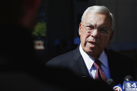 Boston Mayor Tom Menino talks to reporters as he arrives for the Boston College Chief Executives' Club of Boston luncheon in Boston, Massach