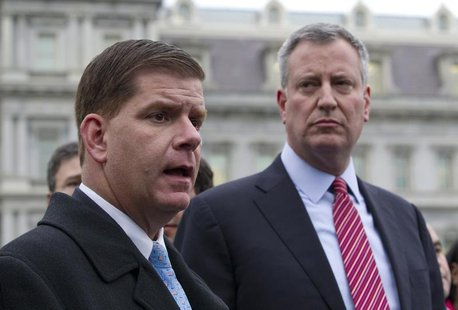 Bill de Blasio and Martin Walsh (L) speak to the press outside the West Wing of the White House in Washington, December 13, 2013, following