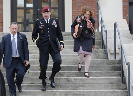 Army Brigadier General Jeffrey Sinclair (C) leaves the courthouse with attorneys Richard Scheff (L) and Ellen Brotman at Fort Bragg in Fayet