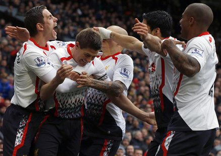 Liverpool's Steven Gerrard (2nd L) celebrates scoring his second penalty against Manchester United with team mates during their English Prem