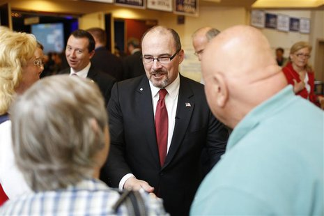 California Republican gubernatorial primary candidate Tim Donnelly (C) greets a well-wisher after delivering a speech at the California Repu