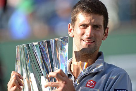 Mar 16, 2014; Indian Wells, CA, USA; Novak Djokovic (SRB) with the championship trophy after winning the BNP Paribas Open against Roger Fede