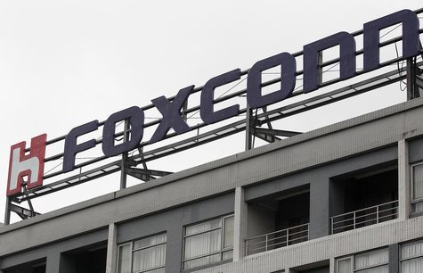 The logo of Foxconn, the trading name of Hon Hai Precision Industry, is seen on top of the company's headquarters in Tucheng, New Taipei cit