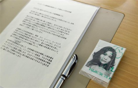 A picture of abduction victim Yaeko Taguchi lays next to the text of her brother Shigeo Izuka, a representative of the Association of the Fa