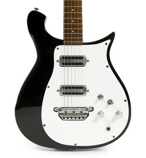 George Harrison's black-and-white 1962 Rickenbacker 425 electric guitar is shown in this handout photo provided by Julien's Auctions March 1