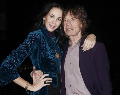 Musician Mick Jagger and designer L'Wren Scott pose following her Fall/Winter 2012 collection during New York Fashion Week, February 16, 201