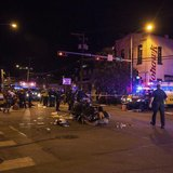 Patients who were struck by a vehicle on Red River Street during the SXSW festival are assisted by paramedics and bystanders in downtown Aus