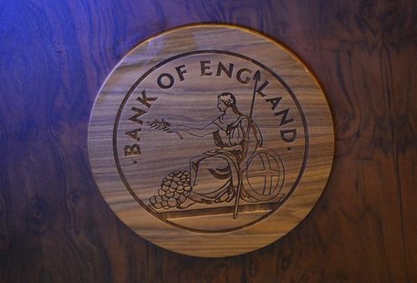 A wooden carving of the Bank of England logo is seen on a desk during the bank's quarterly inflation report news conference at the Bank of E