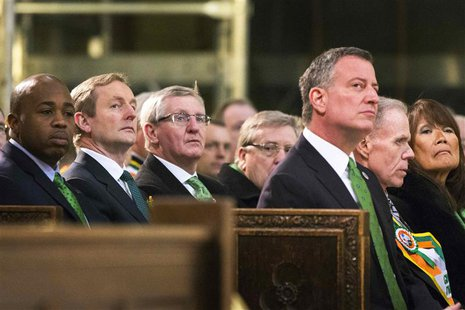 Northern Ireland First Minister Peter Robinson (2nd L) sits with New York Mayor Bill de Blasio (3rd R) during a service at Saint Patrick's C