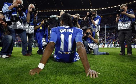 Photographers take pictures of Chelsea's Didier Drogba after their Champions League final soccer match against Bayern Munich at the Allianz