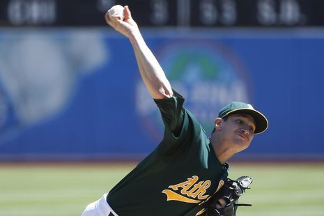 Oakland Athletics starting pitcher Jarrod Parker delivers a pitch against the Texas Rangers during the first inning of their the MLB America