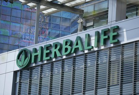 The Herbalife logo is seen on a building housing some of their offices in downtown Los Angeles, California April 28, 2013. Herbalife will re