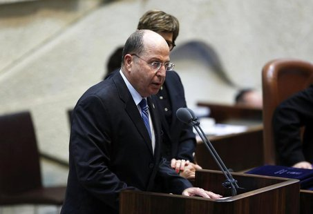 Israel's Defence Minister Moshe Yaalon speaks during a swearing-in ceremony, at the Knesset, Israeli Parliament, in Jerusalem March 18, 2013